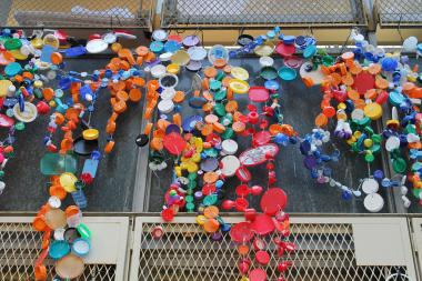 More than 1,000 bottle caps went into a mural outside the school.
