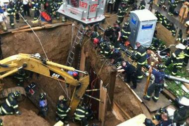 Firefighters work to rescue a worker who got stuck in the mud after a 25-foot deep trench collapse at 119-02 83rd Avenue in Kew Gardens, Queens, Tuesday afternoon, June 18, 2013.