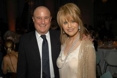 Billionaire Ron Perelman is accused of draining his daughter's inheritance by using the money to pay legal fees in a slew of lawsuits against his former in-laws.