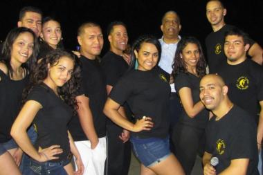 Councilman Leroy Comrie with dancers during a salsa night at Rufus King Park.