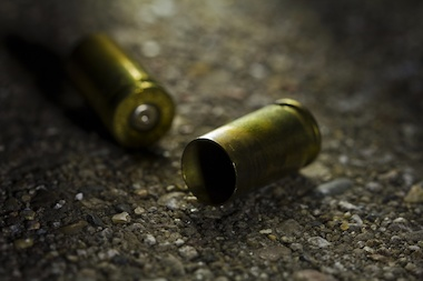 A stock image of shell casings illustrate a dangerous weekend in the Bronx, where four died of gunshot wounds over the weekend of October 19 and 20.
