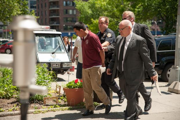 UPPER WEST SIDE - Suspect Franklin Reyes, 18, is led into the 24th Precinct Stationhouse on 100th Street on Tuesday June 4, after allegedly plowing his SUV into 4-year-old Ariel Russo and her 58-year-old grandmother on West 97th Street near Amsterdam Avenue in Manhattan.