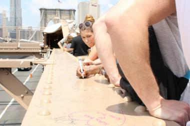 Tourists and graffiti artists are scrawling messages on the Brooklyn Bridge.