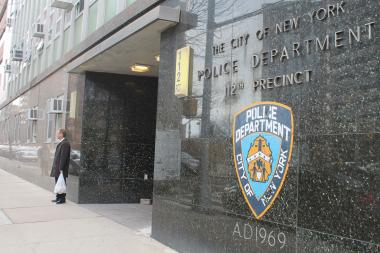 An off-duty police officer, who works at the 112th Precinct, was assaulted and robbed on Sunday night on Austin Street in Forest Hills.