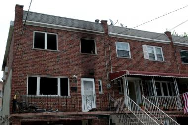 Three people were injured and one woman died in a fire at 326 Swinton Ave. on Friday, July 12, 2013.