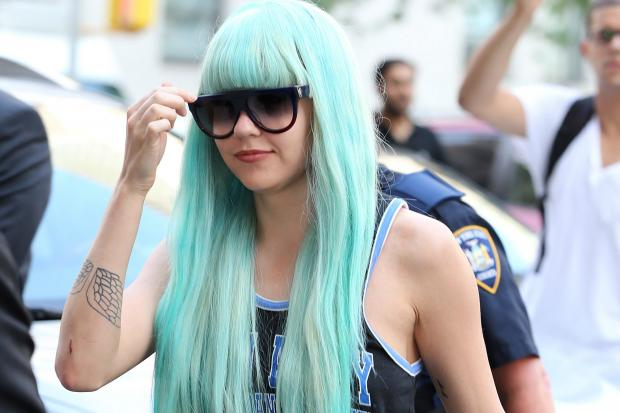 Amanda Bynes donned a new wig during her appearance in Manhattan Criminal Court Tuesday, July 9, 2013, on charges she threw a bong out of the window of her high-rise Midtown apartment