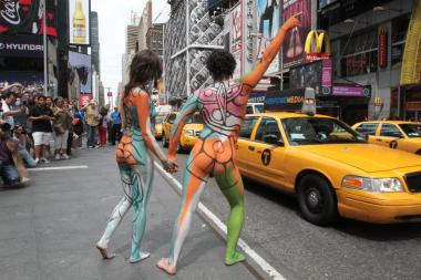 Artist Andy Golub painted nude models Gianna James and Ethan Itzkoff in Times Square Wednesday afternoon, July 10, 2013.