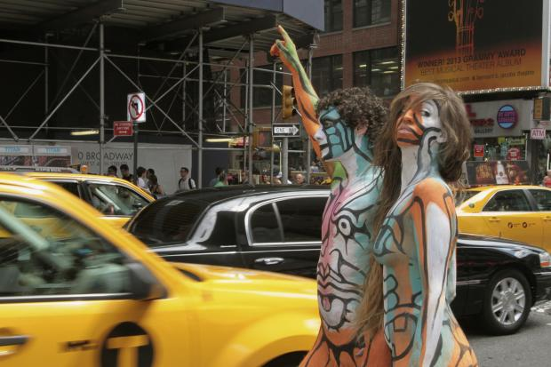 The models will get painted at Columbus Circle and then parade down Broadway to Times Square.
