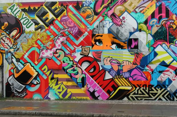 Graffiti artists Pose and Revok announced their visit to New York City by adding their mural to the famous wall.
