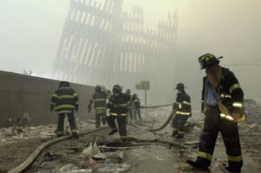 Firefighters work through a toxic dust cloud at Ground Zero on 9/11.