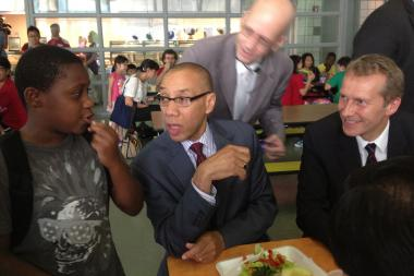 French Minister Guillaume Garot samples school cuisine along with Schools Chancellor Dennis Walcott at Queens College School of Math, Science and Technology on July 2, 2013.