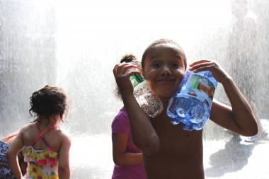 Public sprinklers are a great way to beat the heat and escape the busy neighborhood.