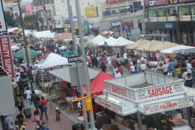 An image of the Jamaica JAMS festival on Jamaica Avenue when streets are closed off to vehicular traffic.