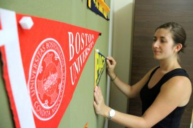 Kristin Levine, head of Great Oaks Charter School on the LES, began hanging up college pennants to get her students focused on higher education.