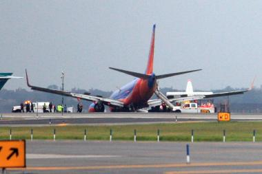 Federal investigators said Southwest Flight 345 landed on its front gears first.