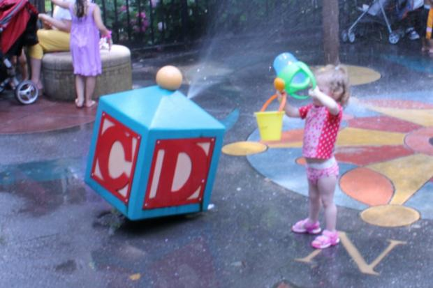 Kids cool off in Madison Square Park, Union Square, St. Vartan Park