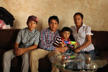 Demis Valdez, 12, Axel Valdez, 4, Yan Valdez, 14, with their mother Nancy Peredo, 33, (R) in their Midland Beach home. Peredo fears the family will be separated if she or her husband gets deported from the U.S. back to Mexico.