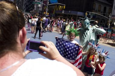 A City Council bill would require all costumed characters in Times Square to wear photo identification.