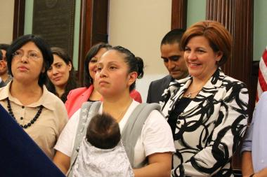 Dolce Rojas, center, with Council Speaker Christine Quinn, right, during the announcement of $18 million in DACA-related funds.