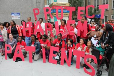 "Holding letters that spelled out ""Protect Harlem Patients,"" nurses and doctors at St. Luke's Hospital rallied Thursday against what they fear are plans by the hospital to no longer maintain a Level I Trauma Center."
