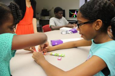 At the DIVAS for Social Justice STEAM Camp, kids make robots and think about their neighborhood.
