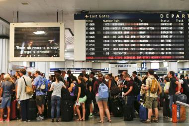 Travelers wait for their trains at Penn Station in 2013.