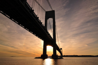 Gov. Andrew Cuomo announced that the toll relief plan for the Verrazano-Narrows he put out earlier this year has been implemented for commercial drivers, who can expect to see a 20 percent discount on tolls for vehicles that cross the bridge more than 10 times per month.