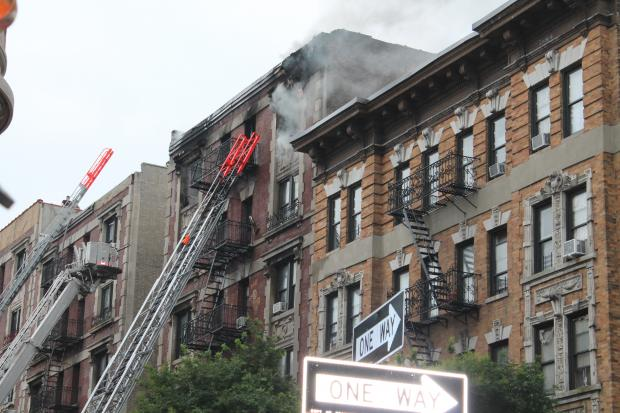 A fire swept through the top floor of a building at 520 W. 139th Street in the Hamilton Heights Section of Harlem on Monday, July 22, 2013.