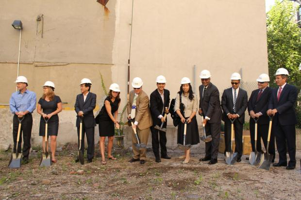 The developers, community officials broke ground Tuesday on the 11-floor hotel, which opens next year.