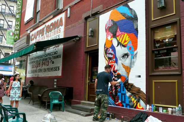 The street artist Tristan Eaton painted a multicolored Audrey Hepburn portrait on a Mulberry Street wall in mid-August 2013.