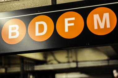 A sign for the B/D/F/M train.