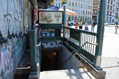 A woman was nearly robbed by two teens aboard an E train near Canal Street on July 30, 2013, she told police.