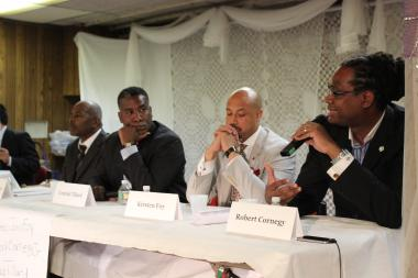From left, Reginald Swiney, Conrad Tillard, Kirsten John Foy and Robert Cornegy debate education policy in Bed-Stuy on Aug. 13.