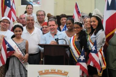 Francisco Gonzalez (at podium) is the longtime district manager of the Bronx's Community Board 9 and also the chairman of the borough's Puerto Rican Day parade. He was fined $7,500 by the city's Conflicts of Interest Board.