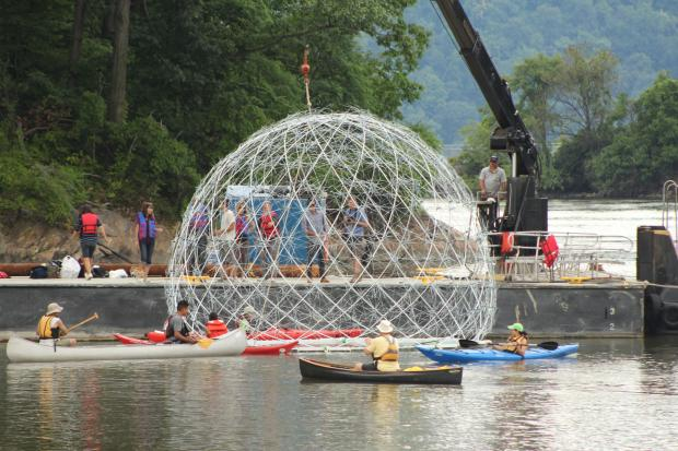 The 24-foot floating sphere of umbrella frames was installed in Inwood Hill Park Wednesday afternoon.