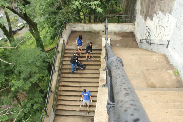 A monthly crew of volunteers has helped spruce up a staircase and hill once known as a magnet for trash and drugs.