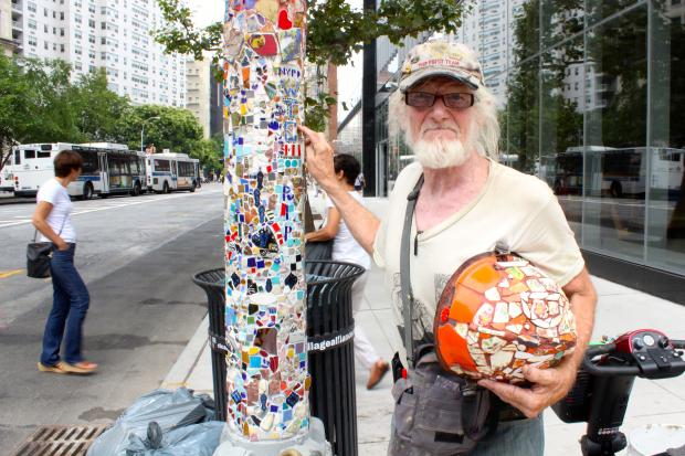 "A pole decorated by Jim ""Mosaic Man"" Power has been temporarily removed from Astor Place."