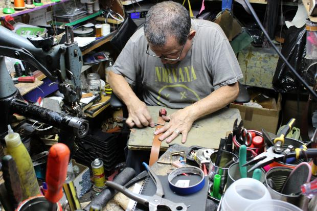 Jim's Shoe Repair Shop has stayed open for 81 years by keeping things old fashioned and prices low.