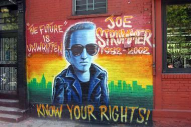 The Joe Strummer mural on East Seventh Street was taken down by construction workers on Monday.