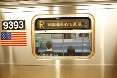 A 25-year-old woman stopped a thief from escaping on an R train, police said.