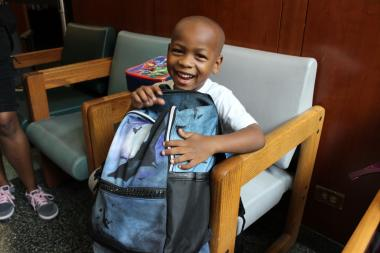 The welfare agency handed out thousands of dollars worth of donated school supplies to needy kids.