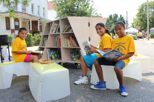 Portable reading room provides books and games for kids.