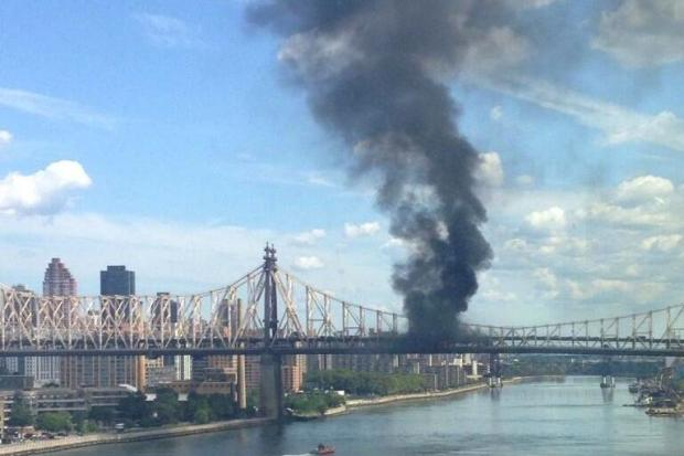 A truck caught fire on the lower level of the Queensboro Bridge Friday morning.