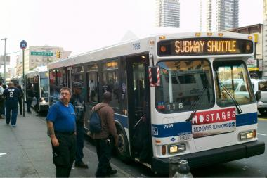 Commuters used a shuttle bus after the 6 train was suspended Monday morning.