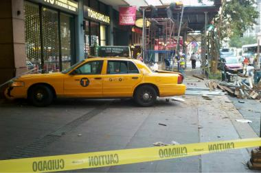A driver was hospitalized when his cab ran into Midtown scaffolding on Friday, witnesses said.