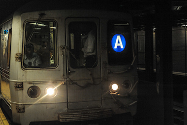 Police said a woman was assaulted by two men on the A train Friday, Feb. 21.