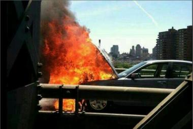 A car burst into flames on the outer span of the Williamsburg Bridge on Aug. 5, 2013.