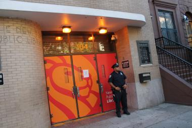 Police stood guard Sept. 5 outside of the Countee Cullen Library branch on West 136th Street in Harlem where an 8-year-old girl was attacked, police say.