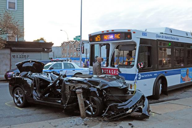 About 43 people were injured when a car fleeing police crashed into a city bus.