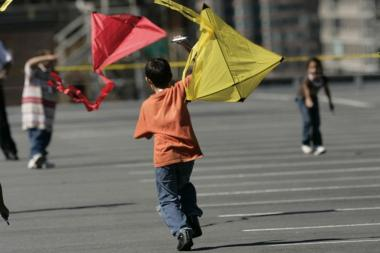 "A young kite enthusiast dashes across the roof of the Port Authority Bus Terminal at the Fashion Center's eighth annual ""Kite Flight"" in September 2012. The event is scheduled to return Sunday, Sept. 22, 2013."